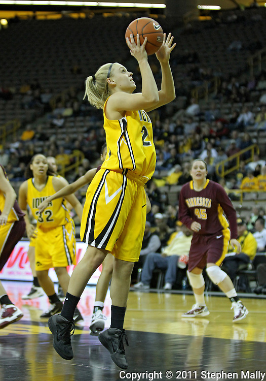 February 10 2011: Iowa Hawkeyes guard Jaime Printy (24) puts up a shot during the first half of an NCAA women's college basketball game at Carver-Hawkeye Arena in Iowa City, Iowa on February 10, 2011. Iowa defeated Minnesota 64-62.