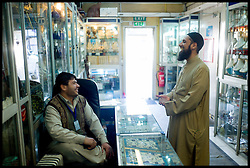 MOD Imam Asim Hafiz  talks to a shop owner in the Isaf HQ in Kabul, Afghanistan, 18th January 2014,Picture by Andrew Parsons / Parsons Media Ltd