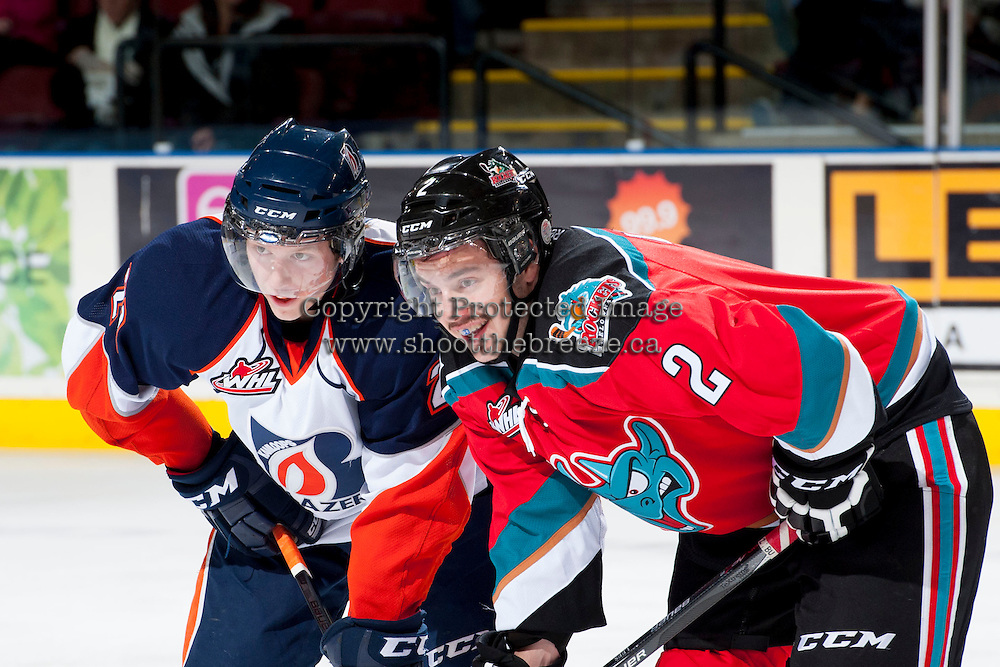 KELOWNA, CANADA - NOVEMBER 30: Cole Ully LW #21 of the Kamloops Blazers lines up against Jesse Lees #2 of the Kelowna Rockets on November 30, 2013 at Prospera Place in Kelowna, British Columbia, Canada.   (Photo by Marissa Baecker/Shoot the Breeze)  ***  Local Caption  ***