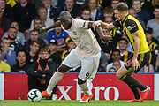 Manchester United Forward Romelu Lukaku battles with Watford defender Craig Cathcart (15) during the Premier League match between Watford and Manchester United at Vicarage Road, Watford, England on 15 September 2018.