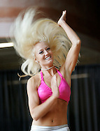 Nicole Moore performs a routine in the finals for prospective Denver Broncos cheerleaders in Denver, Colorado April 1, 2007.  Over 250 women applied for the 34 slots awarded with Moore making the team.  REUTERS/Rick Wilking (UNITED STATES)