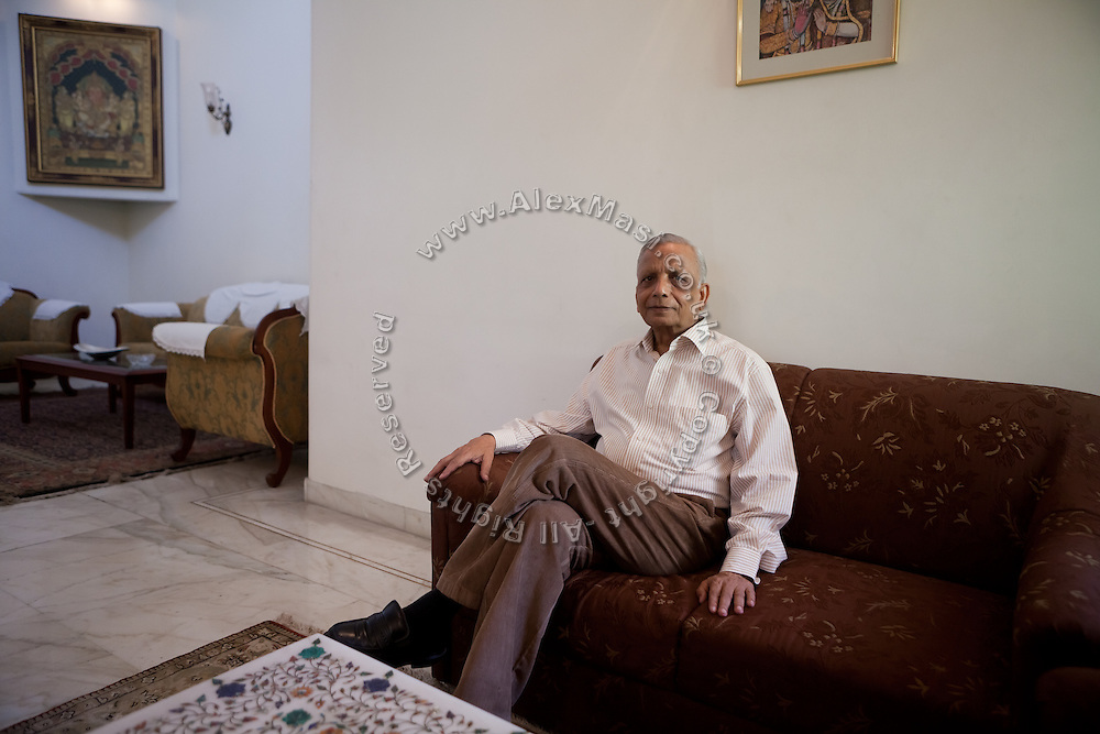 S.M. Khandelwal, the renown Agra businessman and former chairman of the Taj Trapezium Struggle Committee, is sitting on a sofa of his Agra home..