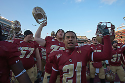 November 20, 2010; Chestnut Hill, MA, USA;  Boston College Eagles cornerback A.J. Currelley (21) celebrates with teammates after the game against the Virginia Cavaliers at Alumni Stadium.  Boston College defeated Virginia 17-13.