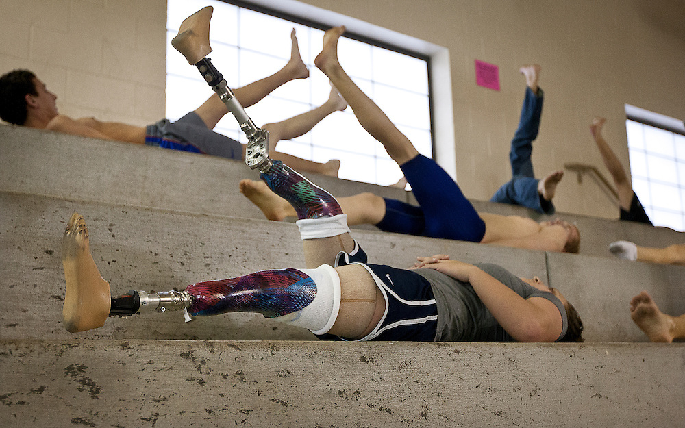 Lehi High School swimmer Amy Chapman performs leg raises during dry land practice at the Lehi Legacy Center, Tuesday, Dec. 18, 2012. Chapman, 17, was born with fibular hemimelia and had both legs amputated when she was 13 months old.