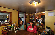 """Pownal, VT -  Friday, Feb. 7, 2014:   Recovering addicts Stephanie Predel, 23, left, and her mom Jennifer Rose, 42, right, at home sitting at their kitchen table.   Federal studies show that Vermont has one of the highest per capita uses of illicit drugs. """"There's just nothing here,"""" said Stephanie Predel, 23, who went from painkillers to heroin, hiding her habit from her children by shooting up in the bathroom. """"Come wintertime, everybody just sits inside using."""" Stephanie, who says she has not used heroin since November, has lost custody of her children. She has no job and no home and for now is staying with her mother, Jennifer Rose, 42, who blames herself for her daughter's descent into drugs. """"Because I had a dysfunctional family growing up, I did a poor job of bringing her up,"""" Ms. Rose said. She said she did not know how to break the cycle.  CREDIT: Cheryl Senter for The New York Times"""
