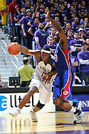 Jan 30, 2008; Manhattan, KS, USA; Kansas State Wildcats forward Bill Walker drives around pressure from Kansas Jayhawks Darrell Arthur (00) in the second half at Bramlage Coliseum in Manhattan, KS.  Kansas State upset the 2nd ranked Kansas Jayhawks 84-75. Mandatory Credit: Peter G. Aiken-US PRESSWIRE