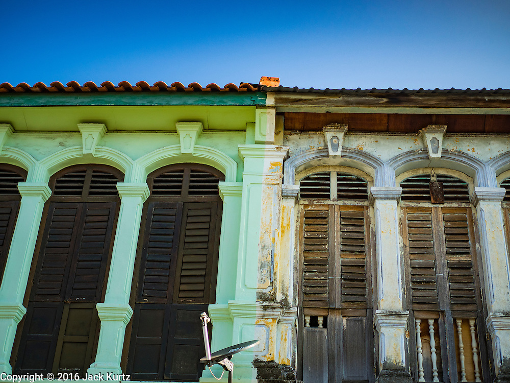 17 NOVEMBER 2016 - GEORGE TOWN, PENANG, MALAYSIA:  Traditional Malaysian shophouses in George Town, Penang, Malaysia. George Town is a UNESCO World Heritage city and wrestles with maintaining its traditional lifestyle and mass tourism.       PHOTO BY JACK KURTZ