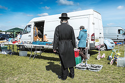 An Orthodox Jew at a boot sale in Essex.
