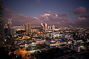 Night aerial of South Beach Florida with Miami skyline in the background