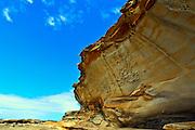 natural rockface at Bare Island, La Perouse damaged by graffiti