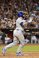 Aug 11, 2017; Phoenix, AZ, USA; Chicago Cubs catcher Alex Avila (13) hits a solo home run in the sixth inning of the MLB game against the Arizona Diamondbacks at Chase Field. Mandatory Credit: Jennifer Stewart-USA TODAY Sports