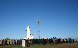 © Licensed to London News Pictures. <br /> 16/12/2014. <br /> <br /> Hartlepool, United Kingdom<br /> <br /> Hundreds of people attend an event on Hartlepool Headland to commemorate the bombardment of Hartlepool by German warships during World War One. During the bombardment 130 civilians were killed and more than 500 were wounded. The Headland's Heugh Gun Battery returned fire in what was the only battle to be fought on British soil during World War One, and one of the Battery's soldiers, Theo Jones of the Durham Light Infantry, became the first British soldier to be killed by enemy action on home ground in the war.<br /> <br /> Photo credit : Ian Forsyth/LNP