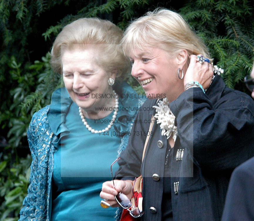 BARONESS THATCHER and her daughter CAROL THATCHER at Sir David & Lady Carina Frost's annual summer party held in Carlyle Square, London on 6th July 2004.