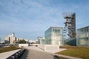 Walkways and paths linking museum site to the city. Silesian Museum, Katowice, Poland. Architect: Riegler Riewe Architekten , 2014.