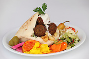 Falafel in pita bread with salad and tahini sauce and pickles