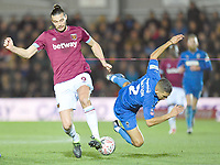 Football - 2018 / 2019 Emirates FA Cup - Fourth Round: AFC Wimbledon vs. West Ham United<br /> <br /> West Ham United's Andy Carroll battles for possession with AFC Wimbledon's Tennai Watson, at Cherry Red Records Stadium (Kingsmeadow).<br /> <br /> COLORSPORT/ASHLEY WESTERN