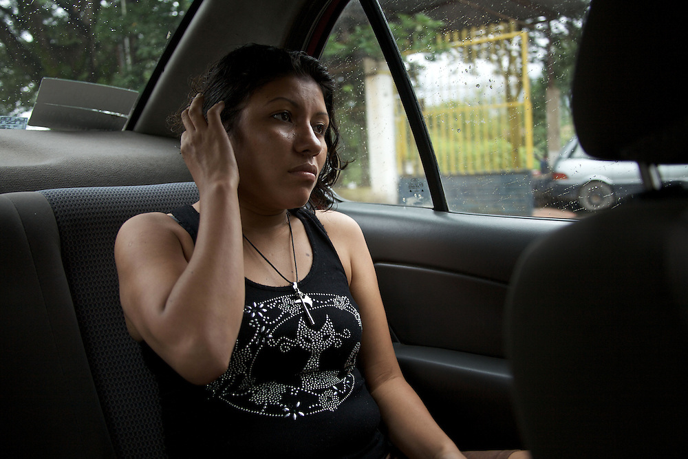 Frontera Comalapa, Chiapas. Milena, 23 from Honduras. She's taking a lift to spend some hours with her small daughter, who now lives in a nearby town with a woman she pays to care for the child. She had this baby with one of her clients. - Prostitution on Mexican Southern Border
