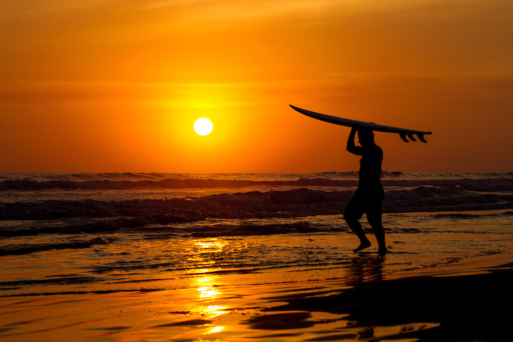 Sunset surfers Cost Rica