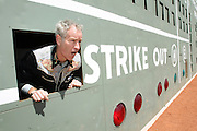 BOSTON, MA.Tennis pro John McEnroe calls out STRIKE from behind the scoreboard during a tour of Fenway Park.