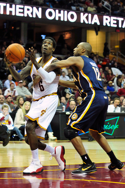 Feb. 2, 2011; Cleveland, OH, USA; Cleveland Cavaliers guard Manny Harris (6) is fouled by Indiana Pacers guard A.J. Price (12) during the second quarter at Quicken Loans Arena. Mandatory Credit: Jason Miller-US PRESSWIRE