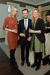 Left to right, the Veuve Clicquot team CHRISTINA JESAITIS, FABRICE OGIER and HANNAH GLYNN at a dinner in honour of Veuve Clicquot Business Woman Award UK Previous Winners held at Moet Hennessy, 18 Grosvenor Gardens, London on 8th April 2014.