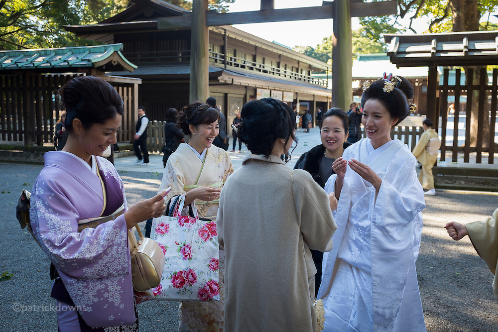 Bridal party laughs just after the wedding at Meiji Shrine, Tokyo.