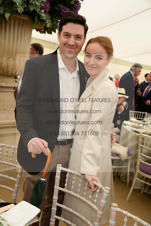 KHALED KHAWAJA and his wife RASHA SAID at the 2013 Cartier Queens Cup Polo at Guards Polo Club, Berkshire on 16th June 2013.