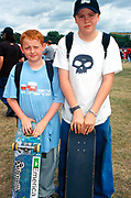 Two teenage boys standing with their skateboards at Urban Games/Board X Clapham Common London UK 1990's