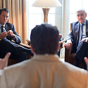 Lance Armstrong, left, and John R. Seffrin, PhD, President of the American Cancer Society, discuss cancer and health care issues with Politico's Patrick Gavin (foreground) at the Mandarin Oriental hotel in Washington on Thursday, Mar. 24, 2011.  (Photo by Jay Westcott/Politico)