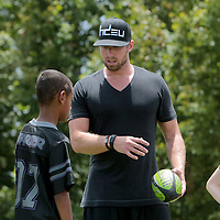 Connor Barth talks to children about place kicking Sunday July 13, 2014 during a kicking clinic at Hoggard High School in Wilmington, N.C. (Jason A. Frizzelle)