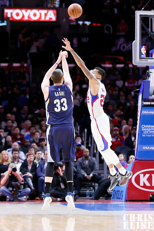 23 February 2015: Memphis Grizzlies center Marc Gasol (33) takes a jump shot over Los Angeles Clippers forward Matt Barnes (22) during the Memphis Grizzlies 90-87 victory over the Los Angeles Clippers, at the Staples Center, Los Angeles, California, USA.