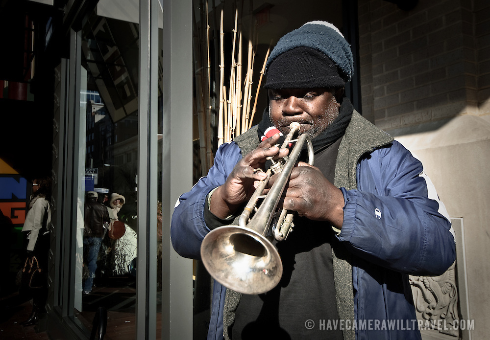 Jazz trumpeter busking on the street in downtown Washington, DC