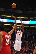 Apr 18, 2010; Phoenix, AZ, USA; Phoenix Suns forward Amare Stoudemire (1) puts up a basket during the first quarter in game one in the first round of the 2010 NBA playoffs at the US Airways Arena.  Mandatory Credit: Jennifer Stewart-US PRESSWIRE