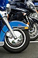 Motorcycles line Lakeside Avenue on Thursday.  (Karen Bobotas/for the Laconia Daily Sun)