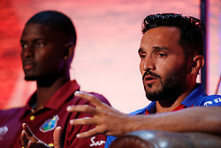 Afghanistan's Gulbadin Naib and West Indies' Jason Holder (left) during the Cricket World Cup captain's launch event at The Film Shed, London.