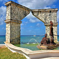 Monument of Two Cultures in San Miguel, Cozumel, Mexico <br /> A Spanish crew was shipwrecked off the Yucat&aacute;n Peninsula coast in 1511. Of the 15 sailors enslaved by the Mayans, only two survived. The figure holding the spear is a tribute to one of them: Gonzalo Guerrero. He embraced the Mayan culture, married a princess named Zazil Ha and had three children. They were the first mestizos, a mix of European and Amerindian. Guerrero died in 1536 while defending against the Spanish. This Monument of Two Cultures is along the waterfront on Avenue Rafael Melgar.