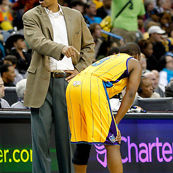 January 22, 2011; New Orleans, LA, USA; New Orleans Hornets head coach Monty Williams points to point guard Chris Paul (3) during the third quarter in a game against the San Antonio Spurs at the New Orleans Arena. The Hornets defeated the Spurs 96-72.  Mandatory Credit: Derick E. Hingle