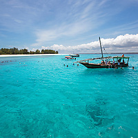 Swimming in the crystal clear waters off Mnemba Atoll.