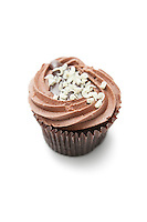 Delicious chocolate cupcake against white background