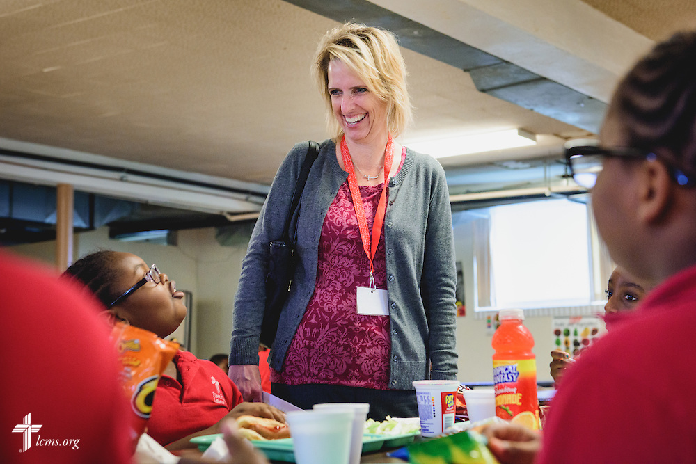 Dr. Melissa Sandfort, Principal of Child of God Lutheran school, St. Peters, Mo., chats with students during accreditation at River Roads Lutheran School on Monday, Oct. 3, 2016, in St. Louis. LCMS Communications/Erik M. Lunsford