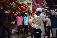 People at mausoleum of Sufi saint Hazrat Nizamuddin in Delhi, some bring offerings  of flowers while others just visiting the temple complex.