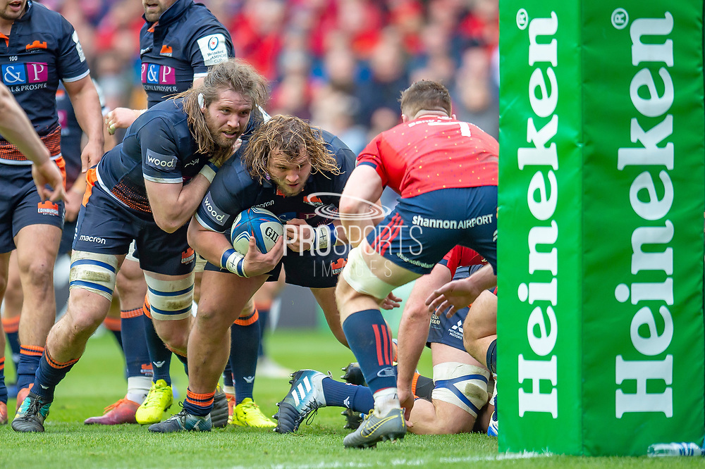 Pierre Schoeman (#1) (with ball) and Ben Toolis (#4) of Edinburgh Rugby make a charge for the try line during the Heineken Champions Cup quarter-final match between Edinburgh Rugby and Munster Rugby at BT Murrayfield Stadium, Edinburgh, Scotland on 30 March 2019.