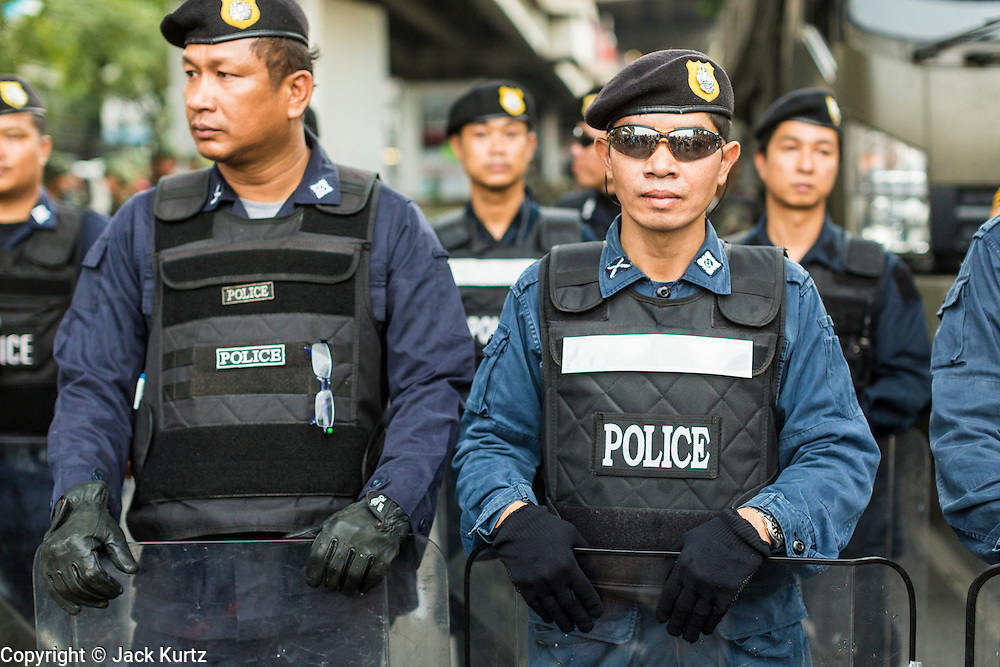 26 MAY 2014 - BANGKOK, THAILAND: Police line up during a protest against the coup in Thailand at Victory Monument during a pro-democracy rally in Bangkok. About two thousand people protested against the coup in Bangkok. It was the third straight day of large pro-democracy rallies in the Thai capital as the army continued to tighten its grip on Thai life.   PHOTO BY JACK KURTZ