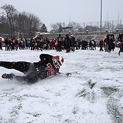 Malaki Holan, New Canaan, celebrates victory by sliding in the snow during the New Canaan Rams Vs Darien Blue Wave, CIAC Football Championship Class L Final at Boyle Stadium, Stamford. The New Canaan Rams won the match in snowy conditions 44-12. Stamford,  Connecticut, USA. 14th December 2013. Photo Tim Clayton