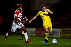 Edward Upson of Bristol Rovers takes on Mallik Wilks of Doncaster Rovers - Mandatory by-line: Robbie Stephenson/JMP - 26/03/2019 - FOOTBALL - Keepmoat Stadium - Doncaster, England - Doncaster Rovers v Bristol Rovers - Sky Bet League One