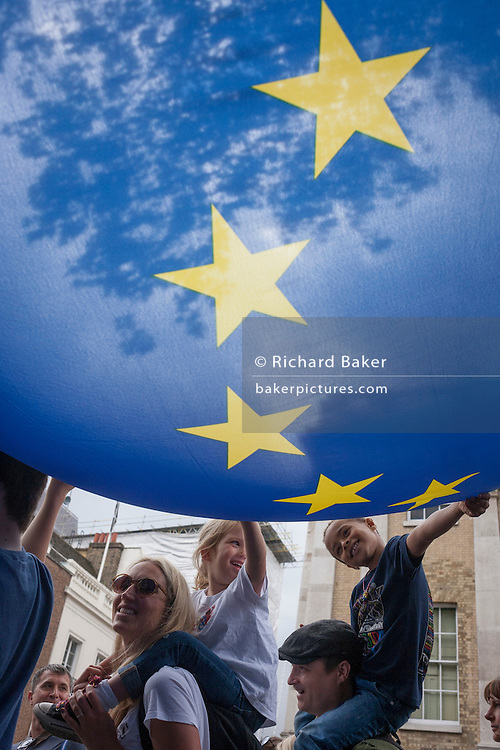 """Thousands of British voters march through London to protest against the referendum decision to leave the EU (Brexit) on 2nd July 2016, in London UK. Demonstrators at the """"March for Europe"""" rally, which was organised on social media walked from Park Lane into the heart of the UK government in Westminster to send a message of dissatisfaction in the referendum result. More than 46.5 million people voted in the referendum on 23 June, which resulted in the UK voting by 51.9% to 49.1% to withdraw from the EU."""