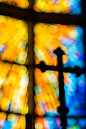 An intentionally unsharp image of the processional cross and cross in the chancel stained glass on Wednesday, May 13, 2020, at St. Paul's Lutheran Church, Columbia, Ill. LCMS Communications/Erik M. Lunsford