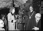 "Molly Malone Statue Unveiled. (R93)..1988..20.12.1988..12.20.1988..20th December 1988..""Dublin's Fair City"" received a millenniun gift to commemorate her most famous daughter, Molly Malone, when Jurys Hotel Group plc presented a specially commissioned sculpture to the people of Dublin. The sculpture was formally handed over by Michael McCarthy, MD,Jurys Hotel Group, to the Lord Mayor of Dublin, Councillor Ben Briscoe, TD, in an unveiling ceremony today at the corner of Grafton Street, Suffolk Street and Nassau Street..Molly Malone was created and fashioned in her traditional 17th century dress by Dublin born artist, Jeanne Rynhart, who was selected from a number of entries for the statue design, by the Dublin Millennium Board...Image shows Lord Mayor, Ben Briscoe and artist Jeanne Rynhart with her depiction of Molly Malone. City manager ,Frank Feely, is to the right in the picture."