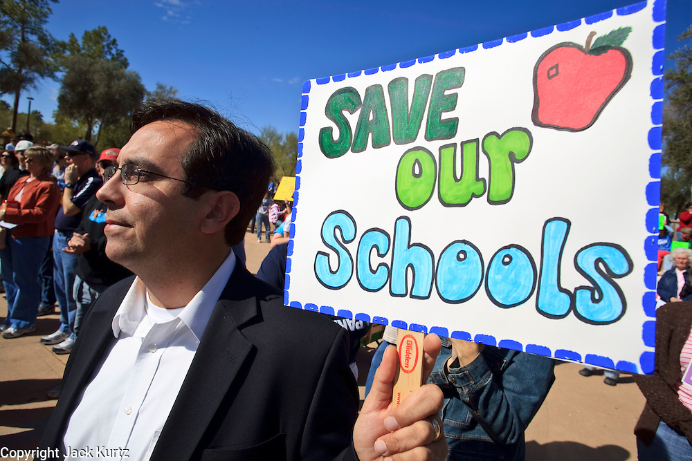 Feb 14, 2009 -- PHOENIX, AZ: VINCE RABAGO, from Tucson, AZ, protests planned budget cuts in Arizona public schools at the state capitol Saturday. About 1,000 people from across Arizona came to the State Capitol Saturday, Feb 14, to rally in favor of state funding for public schools and against budget cuts planned by the Arizona State Legislature. Arizona ranks 49th out of 50 states in per capita spending on public schools. Arizona is facing a massive budget deficit and legislators are expected to cut many state services, including public schools, to balance the budget.  Photo by Jack Kurtz / ZUMA Press