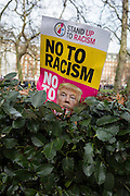 Detail of a placard on a hedge at the Stop Trump's Muslim ban demonstration on 4th February 2017 in London, United Kingdom. The protest was called on by Stop the War Coalition, Stand Up to Racism, Muslim Association of Britain, Muslim Engagement and Development, the Muslim Council of Britain, CND and Friends of Al-Aqsa. Thousands of demonstrators gathered to demonstrate against Trump's ban on Muslims, saying it must be opposed by all who are against racism and support basic human rights, and for Theresa May not to collude with him.